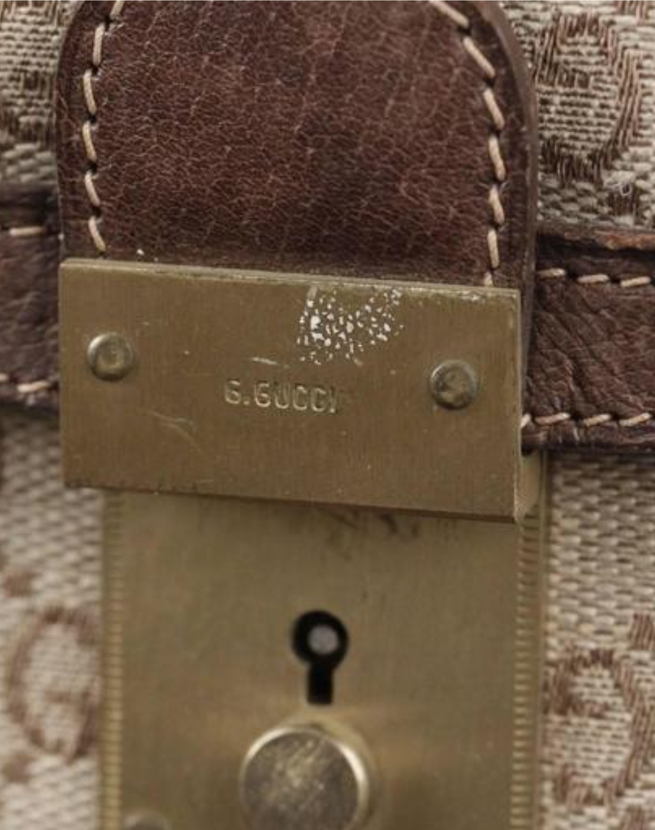 "Vintage Gucci bag wih hardware engraved with ""G.GUCCI"""
