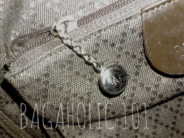e027431f7e2 A GG medallion zipper pull on a brown Gucci nylon canvas tote bag – Tips on  Original Gucci Bags on Sale – How to Tell if a Gucci Bag is Real
