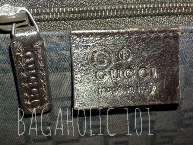A Gucci leather tag with a G inside a circle which is made for outlet - Tips on Original Gucci Bags on Sale - How to Tell if a Gucci Bag is Real