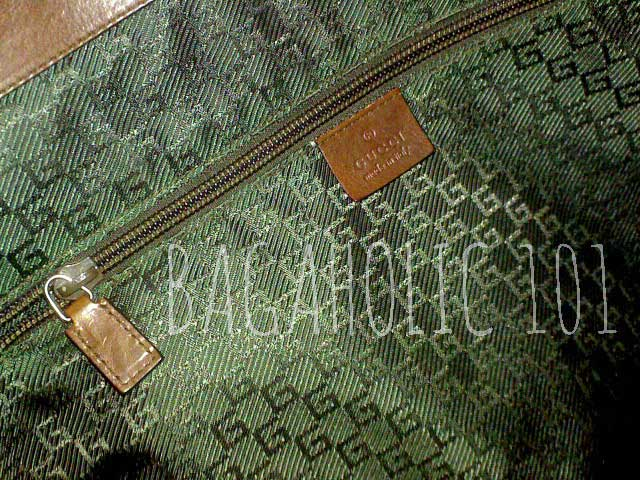 A Gucci luggage with a wide plain smooth leather zipper pull - Tips on Original Gucci Bags on Sale - How to Tell if a Gucci Bag
