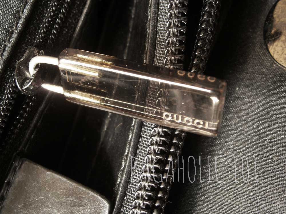 8d06d93fd61 A Gucci zipper pull marked with GUCCI made from transparent Lucite plastic  - Tips on Original
