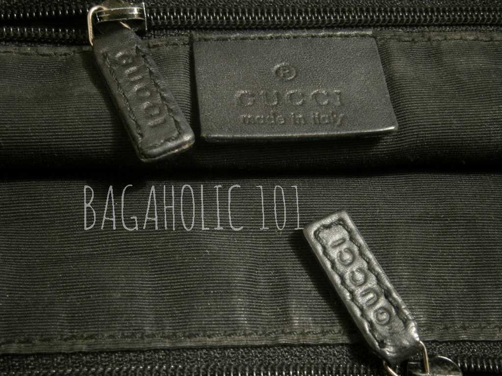 A bag with two GUCCI marked leather zipper pull