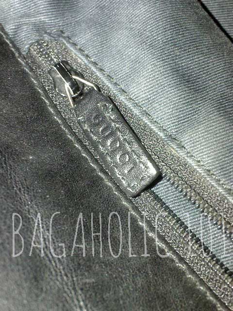 A brown GUCCI marked side pocket leather zipper pull - Tips on Original Gucci Bags on Sale - How to Tell if a Gucci Bag