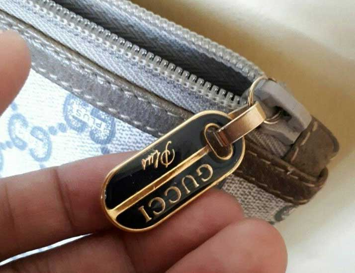 A gold-tone Gucci Plus zipper pull - Vintage Gucci Bag Authentication - Gucci Serial Number Check - How to Tell if a Gucci Bag is Real