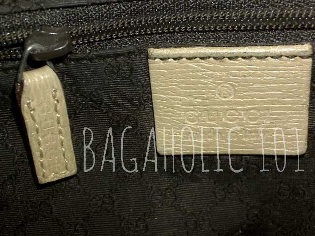 A light-colored GUCCI marked side pocket leather zipper pull - Tips on Original Gucci Bags on Sale - How to Tell if a Gucci Bag