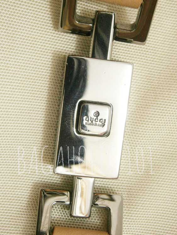 A silver piston lock engraved with GUCCI made in italy - Tips on Original Gucci Bags on Sale - How to Tell if a Gucci Bag
