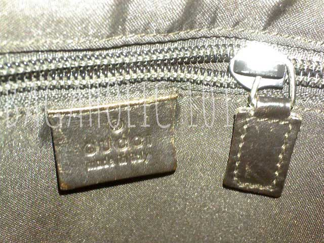 A wide plain leather zipper pull on a brown Gucci bag - Tips on Original Gucci Bags on Sale - How to Tell if a Gucci Bag