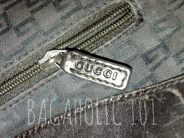 Another GUCCI marked side pocket leather zipper pull - Tips on Original Gucci Bags on Sale - How to Tell if a Gucci Bag