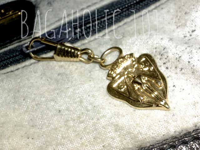 f1af8582afcb1d Another sample of a Gucci knight crest zipper pull - Tips on Original Gucci  Bags on