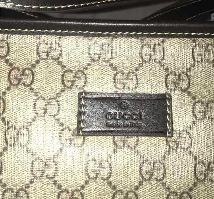Fake Gucci leather rectangle in a brow monogram coated canvas bag - Tips on Original Gucci Bags on Sale - How to Tell if a Gucci Bag is Real
