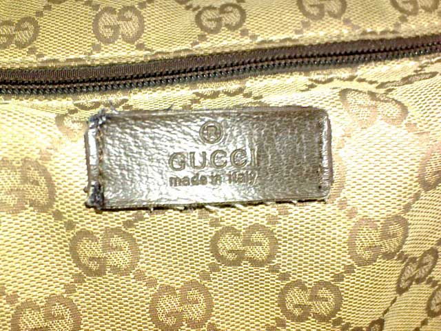 Fake Gucci leather rectangle in a brown monogram canvas bag - Tips on Original Gucci Bags on Sale - How to Tell if a Gucci Bag is Real