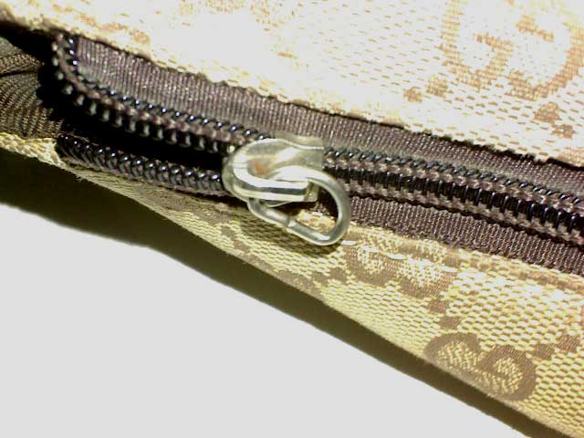 Fake Gucci zipper head - Tips on Original Gucci Bags on Sale - How to Tell if a Gucci Bag is Real