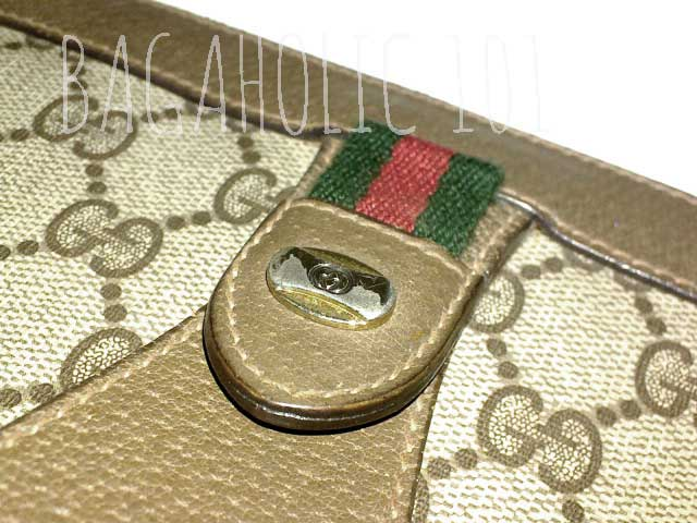 GG engraved hardware on a vintage Gucci accessory collection pouch- Vintage Gucci Bag Authentication - Gucci Serial Number Check - How to Tell if a Gucci Bag is Real
