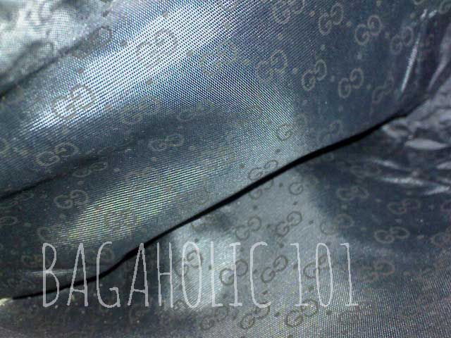 GG monogram lining of a zipped pocket of a navy blue vintage Gucci bag - Tips on Original Gucci Bags on Sale - How to Tell if a Gucci Bag is Real