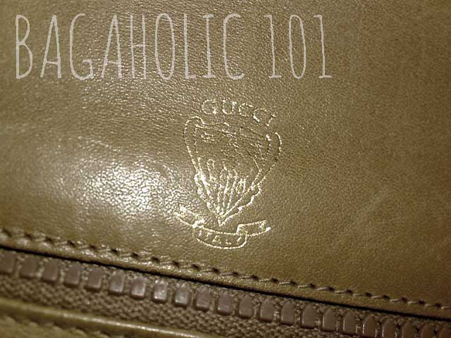 Gold Gucci knight printed in gold on the leather interior of an authentic vintage Gucci Accessory Collection clutch bag - Vintage Gucci Bag Authentication - Gucci Serial Number Check - How to Tell if a Gucci Bag is Real