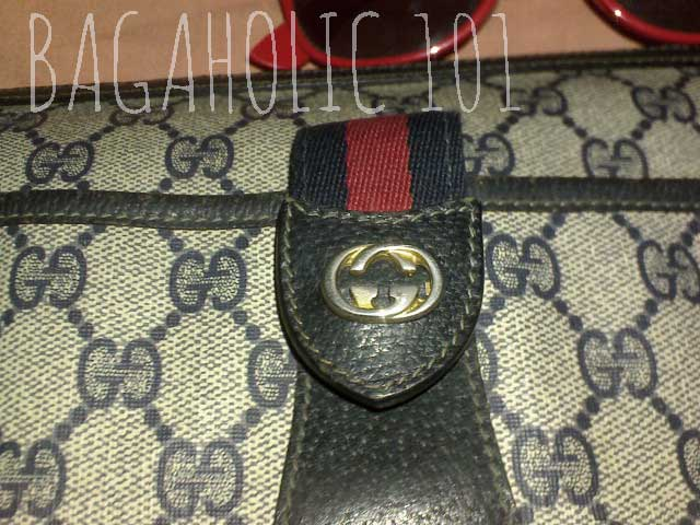 Gold tone GG hardware and signature strip in a vintage Gucci bag - Vintage Gucci Bag Authentication - Gucci Serial Number Check - How to Tell if a Gucci Bag is Real