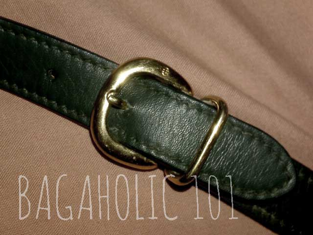 Gold-tone buckle & GG engraving on the strap of a vintage Gucci - Vintage Gucci Bag Authentication - Gucci Serial Number Check - How to Tell if a Gucci Bag is Real
