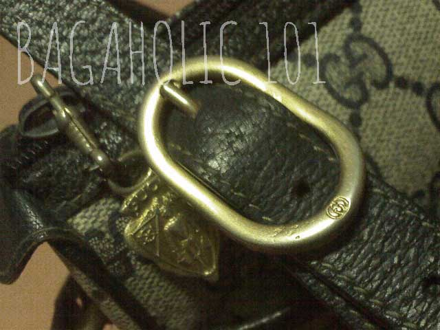 Gucci knight zipper pull and GG engraved gold tone hardware - Vintage Gucci Bag Authentication - Gucci Serial Number Check - How to Tell if a Gucci Bag is Real