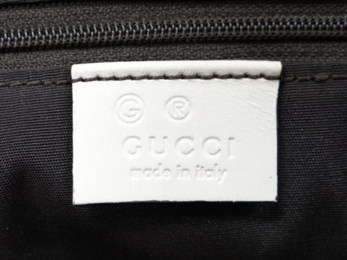 Gucci leather tag marked with G for outlet store 7 - Tips on Original Gucci Bags on Sale - How to Tell if a Gucci Bag is Real