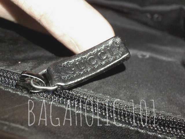 Gucci marked leather zipper pull of an authentic Gucci bag with serial number 001.3218 001274 - Ultimate Guide Before Buying Purses on Ebay