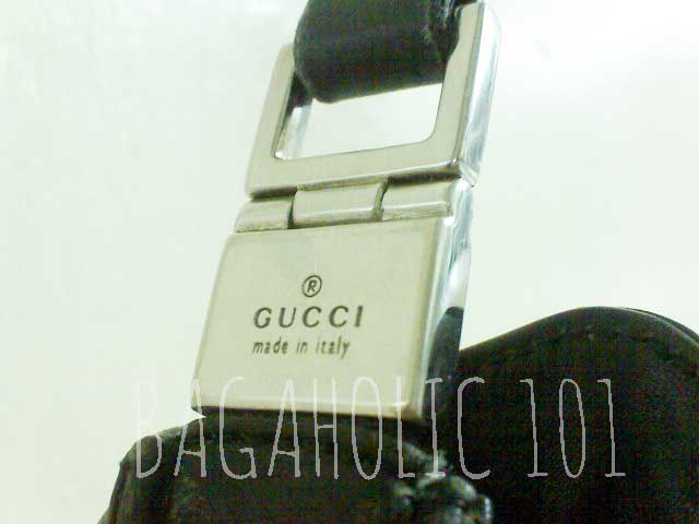 Hardware on the strap of a Gucci bag with serial number 0001-3355 1781- Tips on Original Gucci Bags on Sale - How to Tell if a Gucci Bag