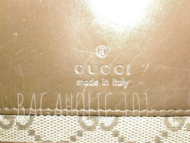 Heatstamp on outside leather of a brown Gucci monogram canvas bag - Tips on Original Gucci Bags on Sale - How to Tell if a Gucci Bag