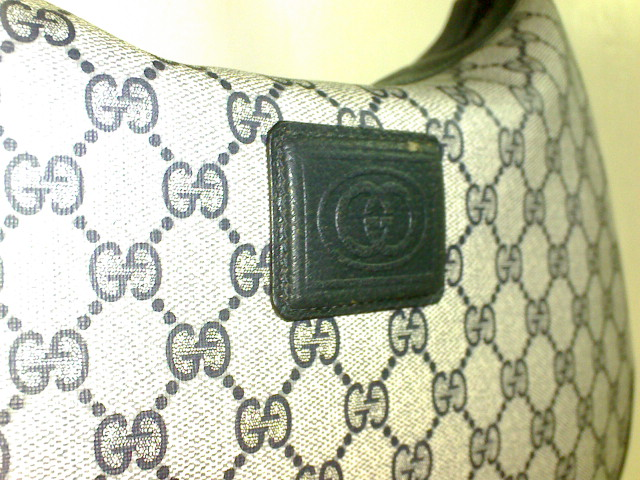 Leather patch marked with the GG logo - Vintage Gucci Bag Authentication - Gucci Serial Number Check - How to Tell if a Gucci Bag is Real