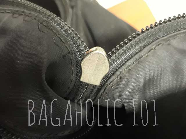 Non-marked underneath of a silver authentic Gucci zipper - Tips on Original Gucci Bags on Sale - How to Tell if a Gucci Bag is Real