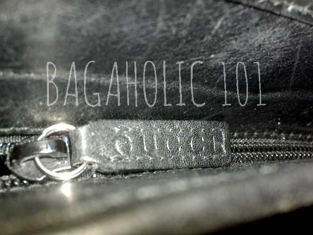 Sample of a GUCCI marked side pocket leather zipper pull - Tips on Original Gucci Bags on Sale - How to Tell if a Gucci Bag