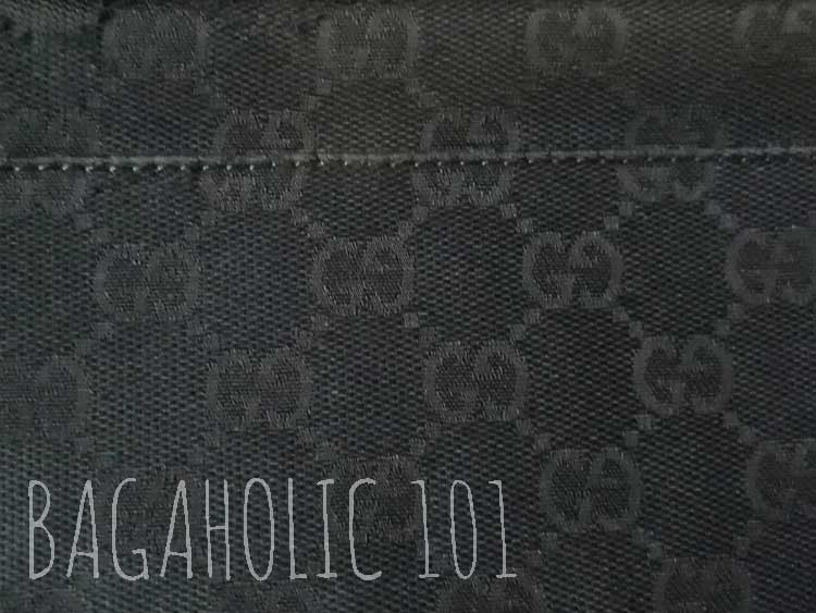 The seams at the bottom of a black Gucci monogram canvas duffle bag - Tips on Original Gucci Bags on Sale - How to Tell if a Gucci Bag is Real