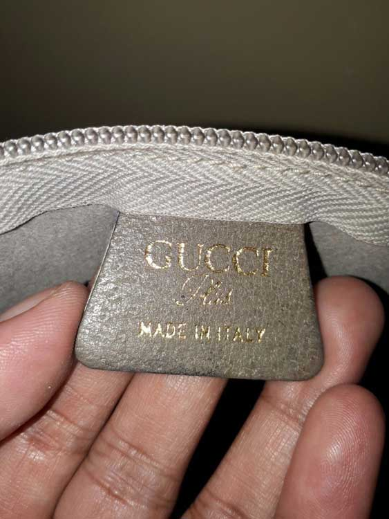Trapezoid leather tag marked with GUCCI Plus MADE IN ITALY - Tips on Original Gucci Bags on Sale - How to Tell if a Gucci Bag is Real