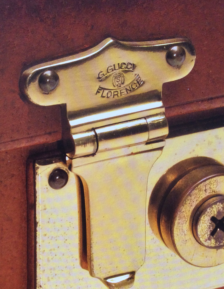 Bagaholic 101 - Gucci Heritage, Icons, and Beyond - 1930s luggage closure hardware with metal engraving in all caps showing 'G. Gucci Florence'