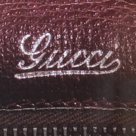 Bagaholic 101 - Gucci Heritage, Icons, and Beyond - 1950's bag interior from showing the 'Gucci' cursive hotstamp in silver