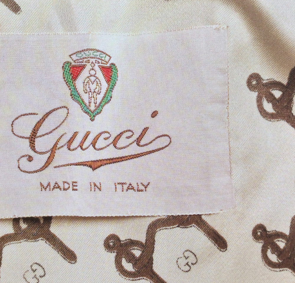 Bagaholic 101 - Gucci Heritage, Icons, and Beyond - Early 1970 jacket label showing the Gucci Crest and 'Gucci MADE IN ITALY' with Gucci Cursive embroidered in embroidered cotton