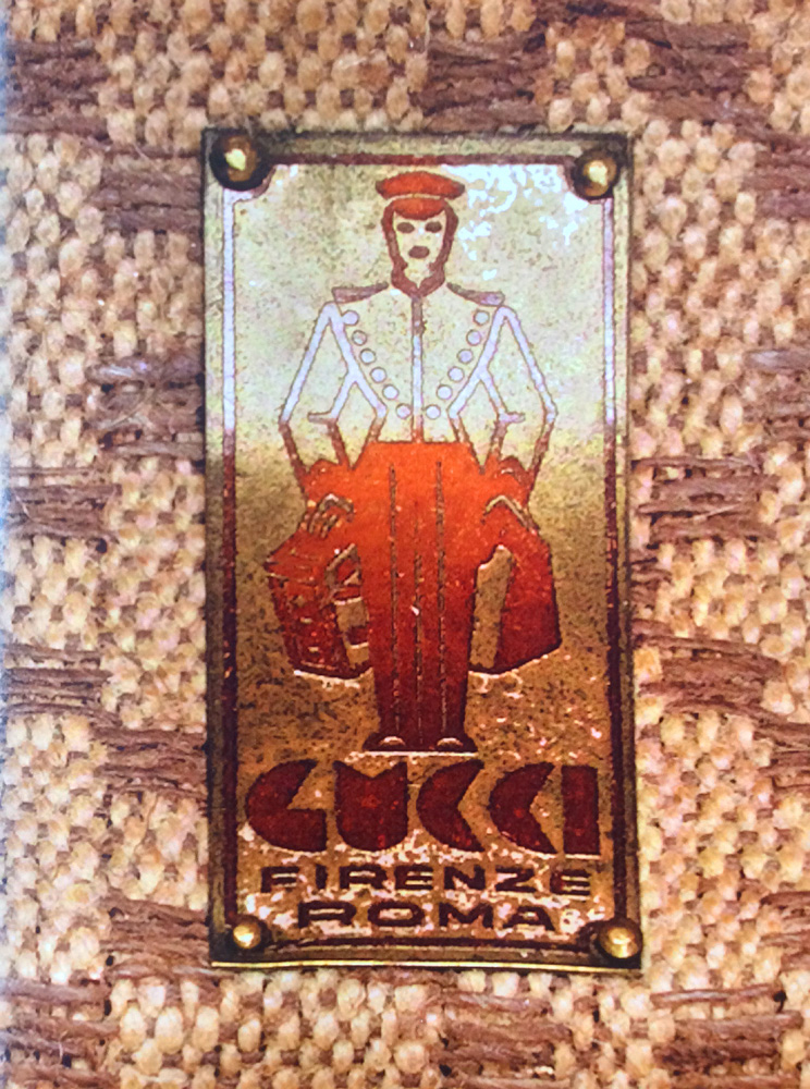 Bagaholic 101 - Gucci Heritage, Icons, and Beyond - Late 1930's Gucci Liftboy emblem in gold metal plate showing 'GUCCI FIRENZE ROMA' (Gucci Florence Rome)