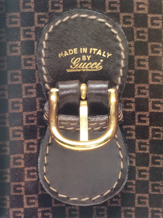 'Made in Italy by Gucci' markings with the Gucci G checkerboard pattern (holding patent 012396)