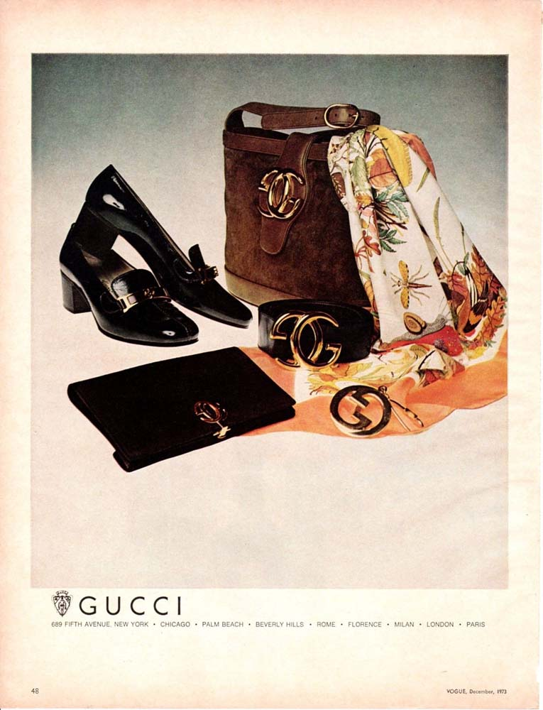 1973 December Gucci print advertisement in Vogue featuring leather bags, shoes, and Gucci Flora silk scarf - Vintage Gucci advertising campaigns archive