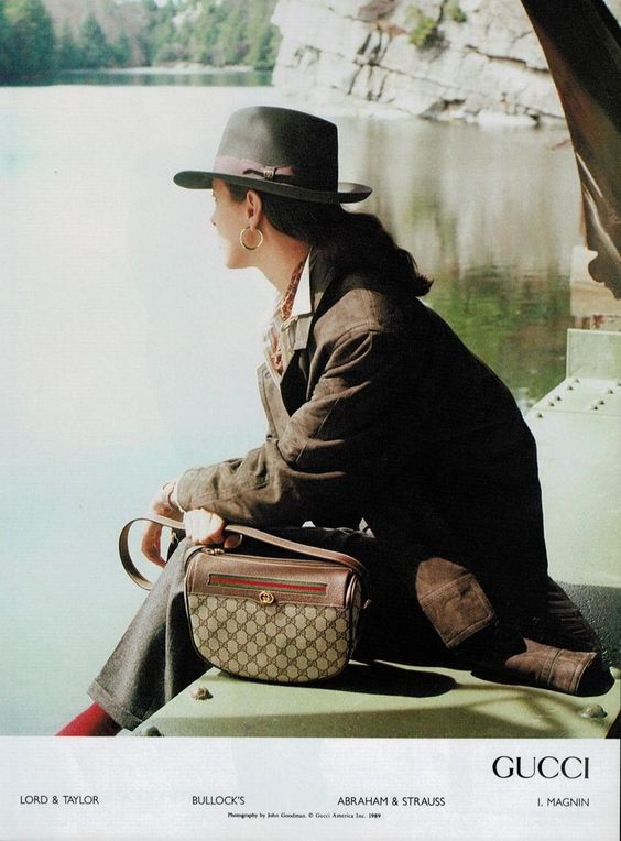 1989 Gucci print ad showing a monogram canvas with red-green stripe shoulder bag - Vintage Gucci advertising campaigns archive