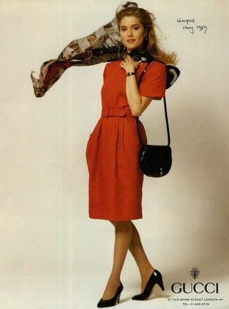 1989 Spring Summer print ad showing a black patent bag, red dress, and silk scarf - Vintage Gucci advertising campaigns archive