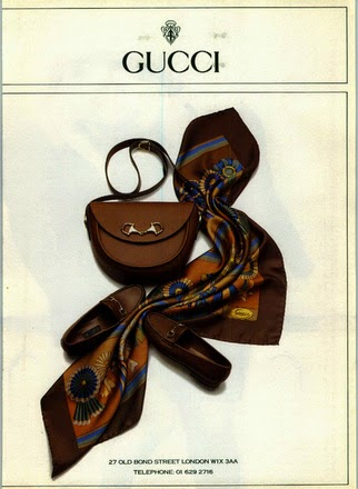 1989 Spring Summer print ad showing a leather bag and loafers with horsebit hardware, and a silk scarf - Vintage Gucci advertising campaigns archive