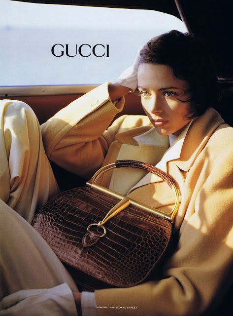 1991 Gucci print advertisement in exotic skin and golden hardware, modeled by Heather Stewart-Whyte - Vintage Gucci advertising campaigns archive