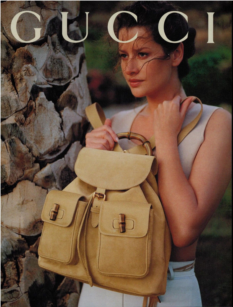 1994 Gucci backpack in suede print advertisement featuring